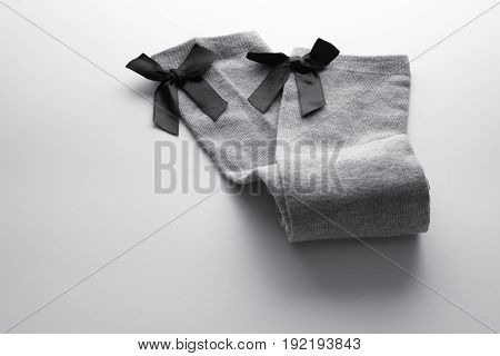 Pair of Kids Stockings on Seamless White Background