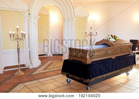 funeral and mourning concept - wooden coffin in christian orthodox church