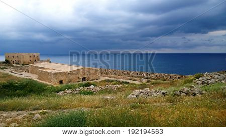 Famous fortress in the town of Rethymno on the island of Crete with beautiful views of the sea in cloudy bright weather