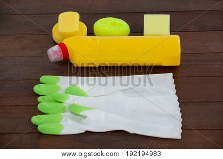 Close-up of cleaning equipment arranged on wooden floor