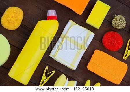 Set of cleaning equipment arranged on wooden floor