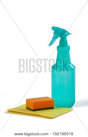 Cleaning spray bottle and sponge on white background