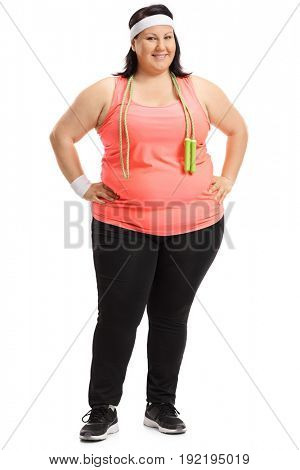 Full length portrait of an overweight woman with a skipping rope isolated on white background