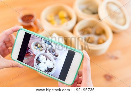 Woman taking photo on chinese dim sum
