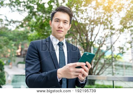 Young business man use of mobile phone