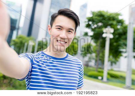 Asian man taking selfie in Hong Kong