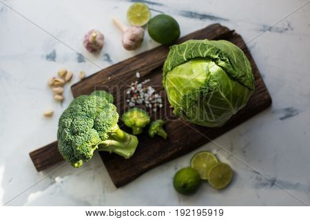 Cabbage on wooden cutting board, view from above