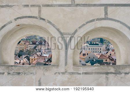 View of Cesky Krumlov through window in old castle, Czech Republic