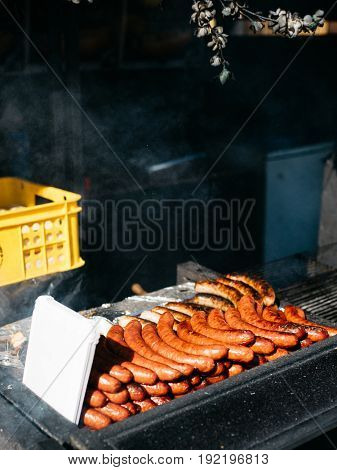 Cooking sausages on barbecue