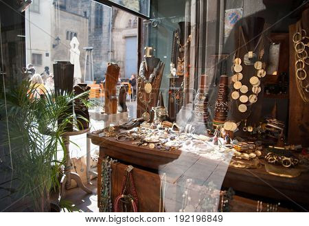 Jewelry in window case at jeweler's shop