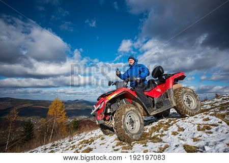 Happy Man On Atv Off-road Vehicle Resting Up In The Mountains And Showing Thumb Up Gesture Of Good C