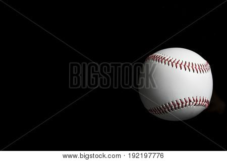 baseball on black background light and shadow