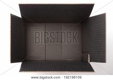 empty black corrugated carton inside horizontal composition