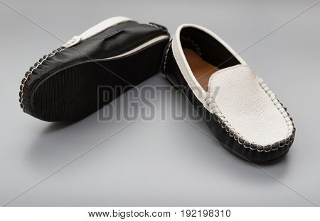 pair of trendy shoes for kids on grey
