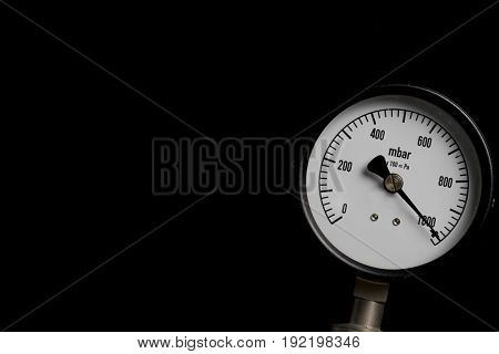 pressure gauge on black background, top view