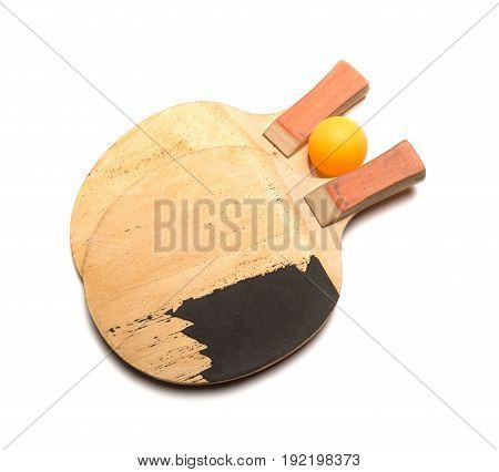 old pingpong rackets and ball on a white background