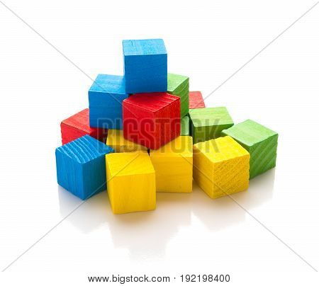 colorful square wooden toy blocks on a white background