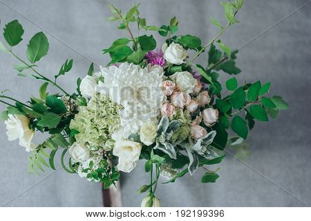 Stylish wedding bouquet from different colors on the bed