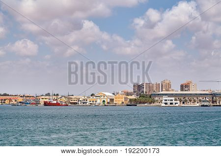 The military area with yellow buildings, in which the entrance is closed. Located in an open area near the port. Cartagena, Spain
