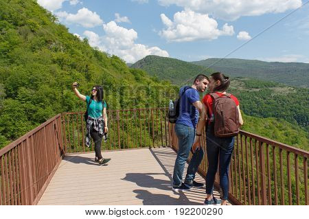 Group travelers travel In the forest of the mountains reserve. Trekking together. Active and healthy lifestyle on summer vacation and weekend tour