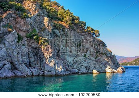 Turquoise water and rocky shore near Turkish coastline