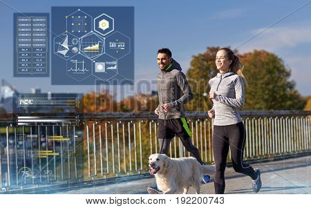 fitness, sport and people concept - happy couple with dog running outdoors