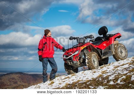 Beautiful Landscape Of Blue Sky With Cirrus Clouds In Front Of A Man Standing In Winter Clothes Near