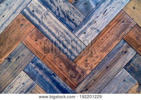 Texture of wooden planks with some spaces between them. Angle view