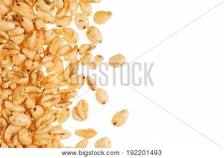 Puffed honey air rice wheat isolated with copy space. Decorative border. Cereals texture.