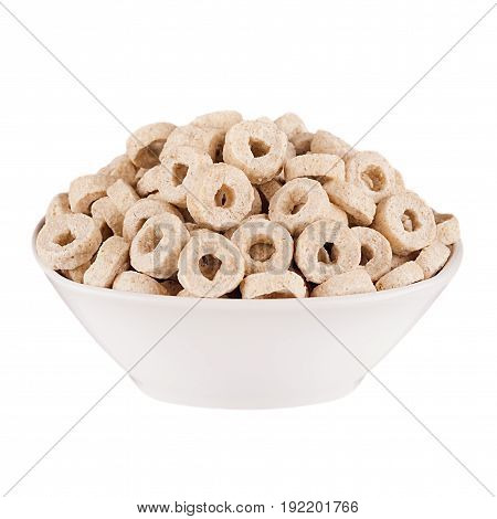 Beige rings corn flakes in white bowl isolated on white background. Cereals.