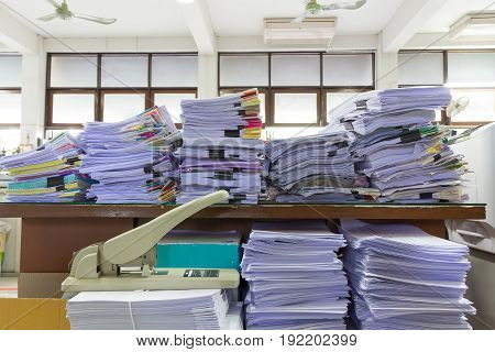 Pile Of Unfinished Documents On Office Desk, Stack Of Business Paper