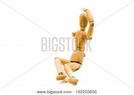 wooden man puppet sitting protecting eyes on white background