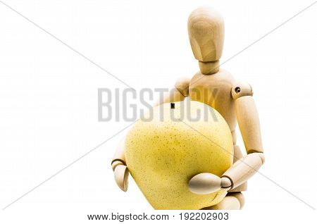 wooden man puppet sitting hugging a pear on white background