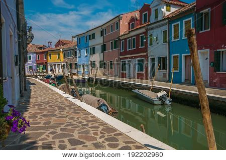 BURANO, ITALY - MAY 23, 2017: Beautiful view of colored houses on the canal of Burano island