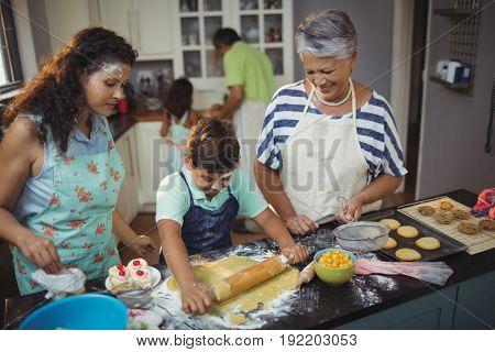 Family preparing dessert in kitchen at home
