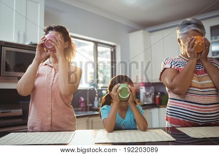 Family having soup in kitchen at home