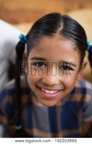 High angle portrait of smiling girl at home