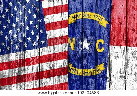 Flag of US and North Carolina painted on wooden frame