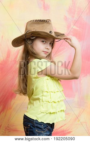 Little Girl In Cowboy Or Cowgirl Outfit With Hat
