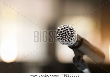 Close up of classic microphone on note stand in bokeh background