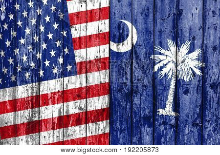Flag of US and South Carolina painted on wooden frame