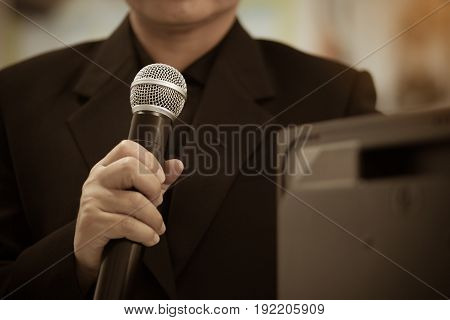 blurred of businessman speech talking with microphone on front room