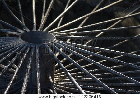 Decorative grid of rebar in the shape of a wheel. Selective focus.