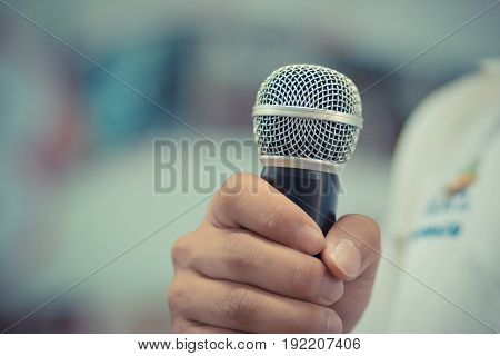 blurred of businessman speech talking with microphone gray scale tone