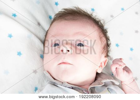 a portrait newborn baby with open eyes
