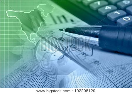 Financial background with map calculator graph and pen in greens and blues.