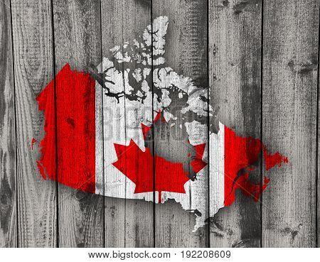 Map And Flag Of Canada On Weathered Wood