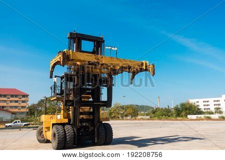 Forklift truck in shipping yard. Business transportation.