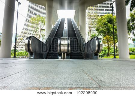 Perspective of escalator and modern building background.