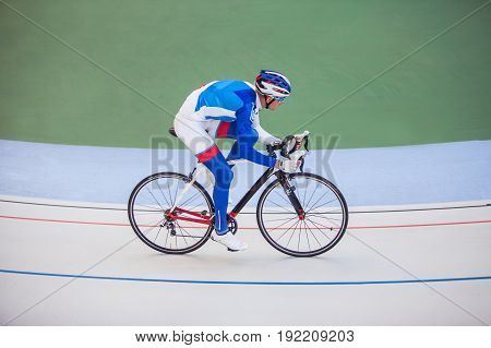 Young professional cyclist on a cycle track